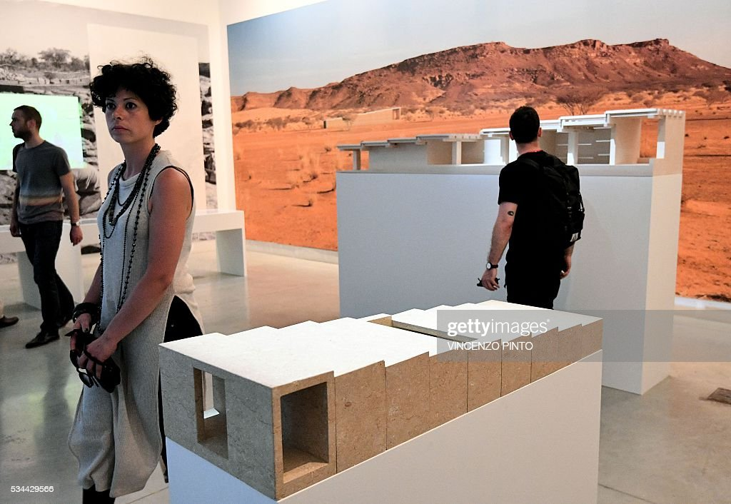 A picture shows projects of building in Sudan made by architect David Chipperfield, during the opening of the 15th International Architecture Exhibition in Venice on May 26, 2016. The Biennale, entitled 'Reporting from the front', curated by Chilean Alejandro Aravena will be open to the public from May 28 through November 27, 2016, in The Arsenal gardens. / AFP / VINCENZO