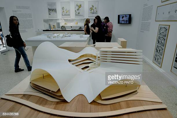 A picture shows projects to repurpose existing industrial structures in Chicago during the opening of the 15th International Architecture Exhibition...