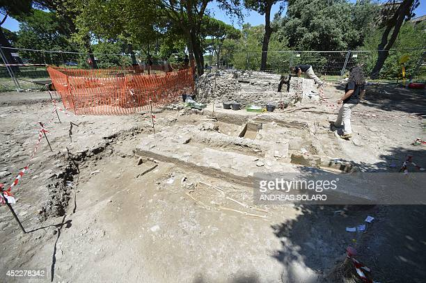A picture shows researches at the Parco dei Ravennati excavation site in Ostia Antica on July 17 2014 near Rome The American Institute for Roman...