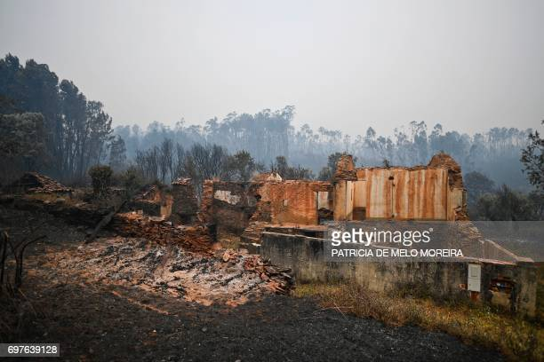 Picture shows ruins of a burnt house destroyed during a wildfire at Pobrais Pedrogao Grande on June 19 2017 More than 1000 firefighters are still...