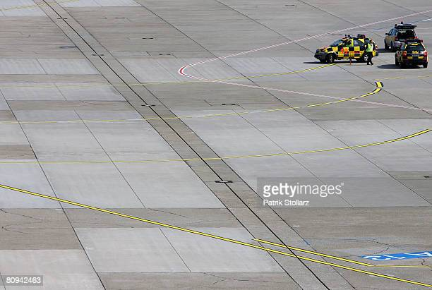 Picture shows service personal waiting for an arriving airplane at the airport Duesseldorf on April 30 2008 in Duesseldorf Germany
