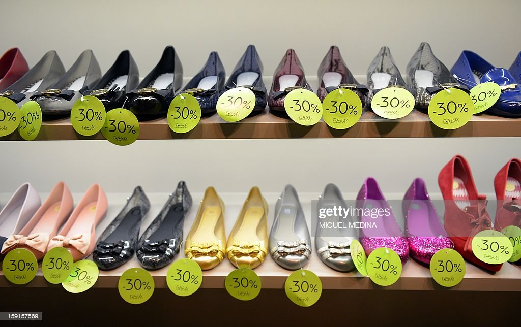 A picture shows shoes with -30% off tags at the Galeries Lafayette department store in Paris, on January 9, 2013, during the official start of winter sales. AFP PHOTO MIGUEL MEDINA