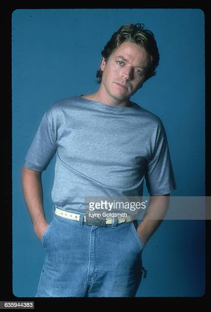 1980 Picture shows singer Robert Palmer posing in a pair of blue pants blue shirt and standing in front of a blue background