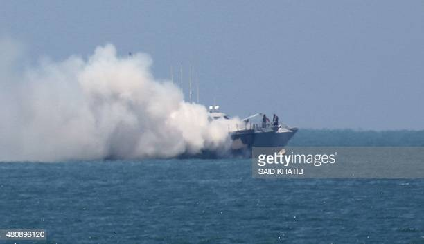 A picture shows smoke billowing from an Egyptian naval vessel on the maritime border between Egypt and the Palestinian Gaza Strip off the coast of...