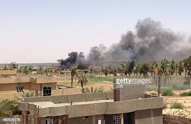 A picture shows smoke billowing from Husayba an Iraqi rural town in the Euphrates Valley seven kilometres east of Ramadi on July 16 2015 Iraq's army...