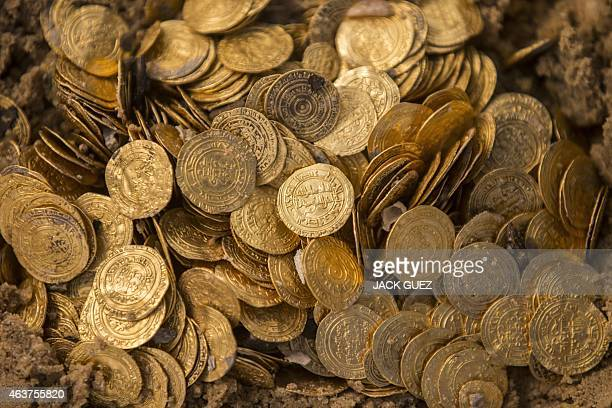 A picture shows some of the gold coins recently found on the seabed off Israel's Mediterranean coast in the Israeli town of Caesarea on February 18...