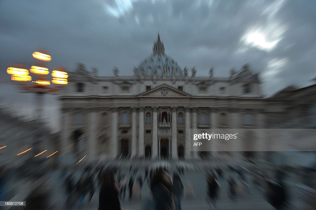 A picture shows St Peter's basilica on the eve of the conclave on March 11, 2013 at the Vatican. Catholic cardinals had a final day of jockeying for position the same day before shutting themselves into the Sistine Chapel to elect a new pope after Benedict XVI's shock resignation, with an Italian and a Brazilian who both head powerful archdioceses among the top contenders. AFP PHOTO / GABRIEL BOUYS