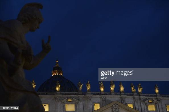 A picture shows statues on the St Peter's basilica during the conclave on March 12 2013 at the Vatican Cardinals moved into the Vatican today as the...