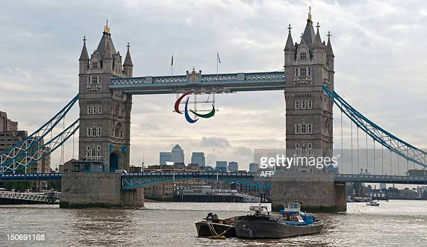 A picture shows the Agitos the logo of the Paralympic movement hanging from Tower Bridge in on August 24 2012 The 2012 Paralympic Games begin on...