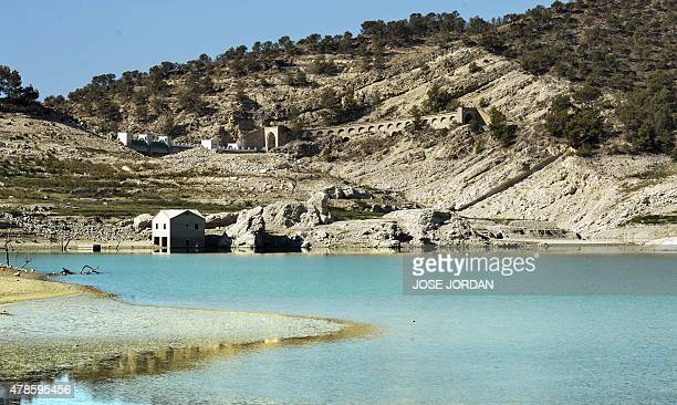 Picture shows the Amadorio reservoir in Villajoyosa near Alicante where the water is far below usual levels due to drought on June 25 2015 AFP PHOTO...