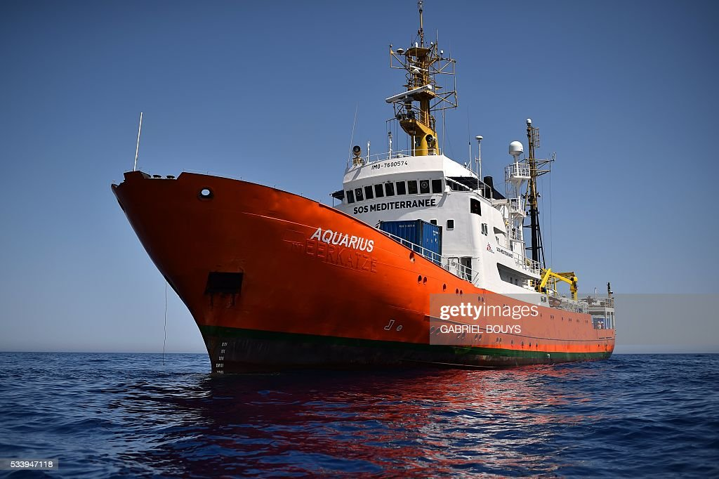 A picture shows the 'Aquarius', a former North Atlantic fisheries protection ship now used by humanitarians SOS Mediterranee and Medecins Sans Frontieres (Doctors without Borders), on May 23, 2016 in the Mediterranean sea in front of the Libyan coast. The 'Aquarius' patrols to rescue migrants and refugees trying to reach Europe crossing the Mediterranean sea aboard rubber boats or old fishing boat. / AFP / GABRIEL