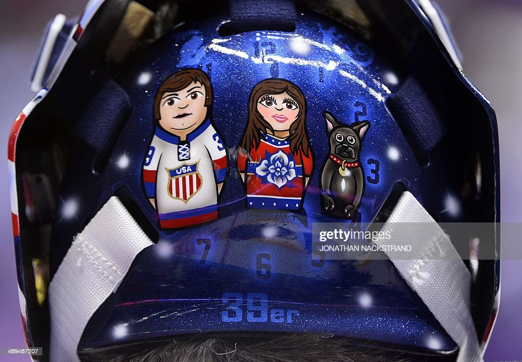 A picture shows the backside of US goalkeeper Ryan Miller's helmet prior the Men's Ice Hockey Group A match USA vs Russia at the Bolshoy Ice Dome during the Sochi Winter Olympics on February 15, 2014 in Sochi.