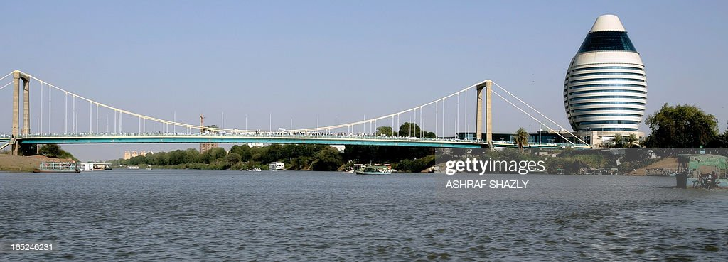 A picture shows the bridge linking the still largely rural island of Tuti in Khartoum with builtup areas on the banks of the Nile during its...