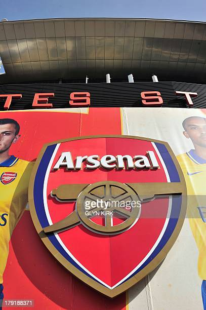 A picture shows the club badge on the outside of Arsenal's Emirates Stadium before the English Premier League football match against Tottenham...