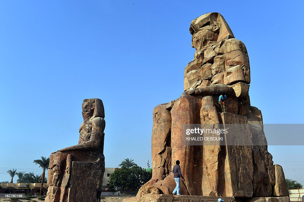 A picture shows the Colossi of Memnon statues on February 27, 2013, in Egypt's ancient temple city of Luxor. AFP PHOTO / KHALED DESOUKI