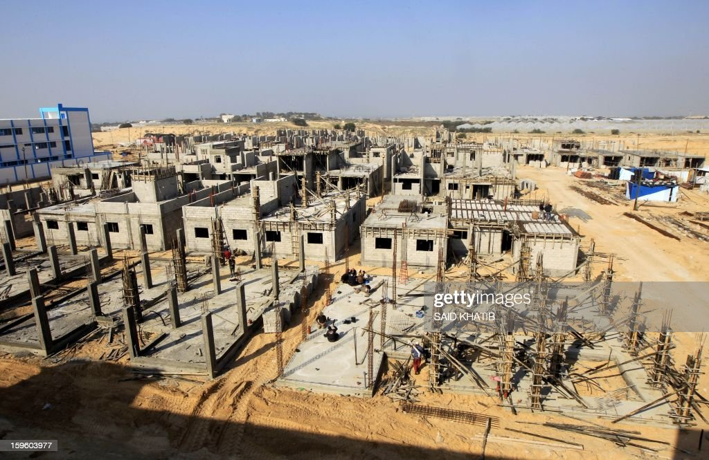 A picture shows the construction site of a residential project funded by the United Nations Relief and Works Agency for Palestine Refugees (UNRWA) in Rafah in the southern Gaza Strip on January 17, 2013. The European Union said it was speeding up disbursement of aid to help ensure there is no interruption in its support for the Palestinian Authority and UN refugee programmes. AFP PHOTO / SAID KHATIB