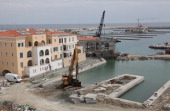 A picture shows the construction site of the Limassol Marina in the Cypriot Mediterranean city on March 19 2013 Europe's main stock markets slid for...