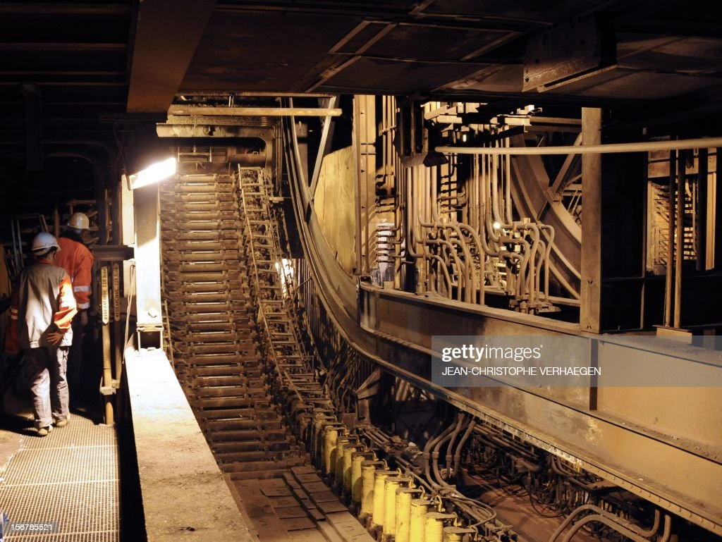 A picture shows the continuous casting slab line of steel in a blast furnace at ArcelorMittal's Florange site, eastern France, on November 20, 2012. ArcelorMittal's management said on November 19, 2012 that the 'situation is even more sluggish in 2013 than in 2012' for some of its activities during an Extraordinary Central Works Council which concluded without providing informations about potential buyers.