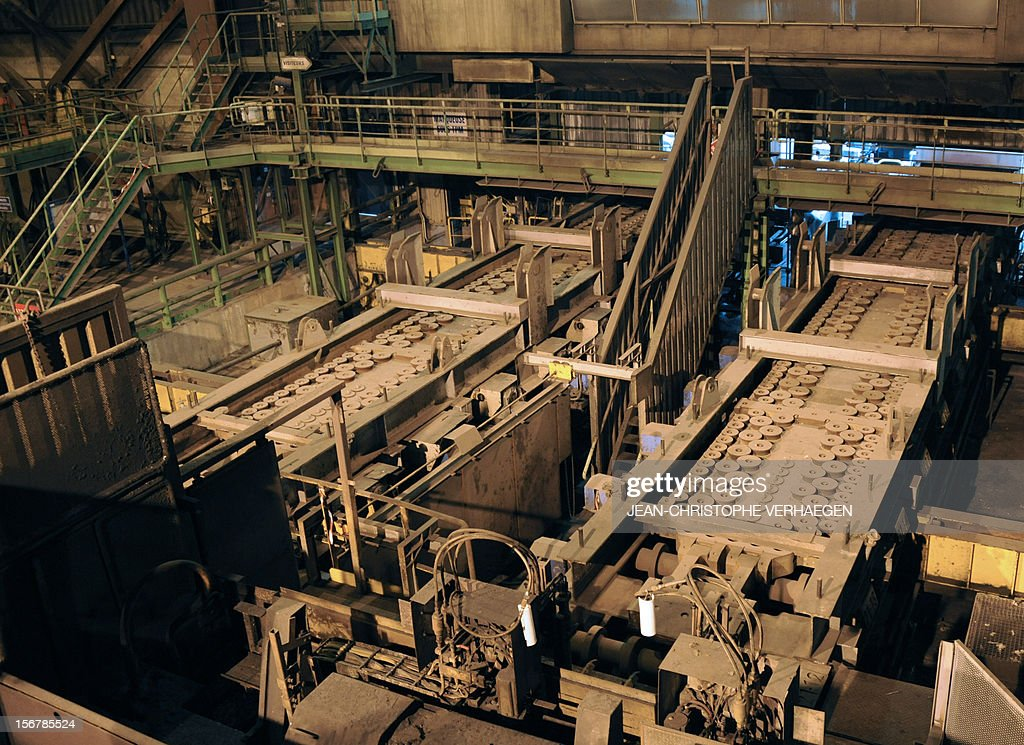 A picture shows the continuous casting slab lines of steel in a blast furnace at ArcelorMittal's Florange site, eastern France, on November 20, 2012. ArcelorMittal's management said on November 19, 2012 that the 'situation is even more sluggish in 2013 than in 2012' for some of its activities during an Extraordinary Central Works Council which concluded without providing informations about potential buyers.
