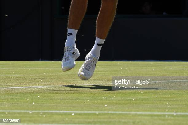 A picture shows the court covered in flying ants as Ukraine's Sergiy Stakhovsky serves against Japan's Kei Nishikori during their men's singles...
