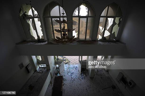 A picture shows the damaged entrance to the local headquarters of Libya's ousted regime in Tawarga on September 25 2011 The people of Tawarga who are...