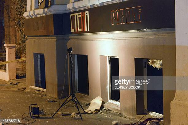 A picture shows the damaged facade of a pub after an explosion in the center of northeastern Ukrainian city of Kharkiv on November 10 2014 Eleven...
