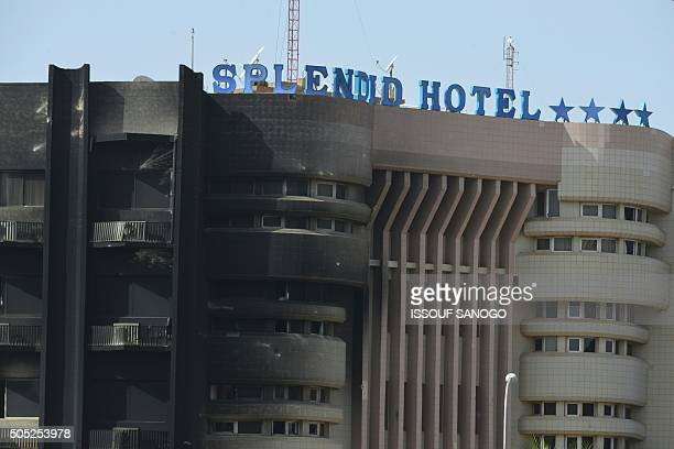 A picture shows the damaged facade of the Splendid hotel following a jihadist attack in Ouagadougou on January 16 2016 At least 26 people many of...