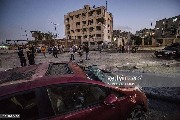 A picture shows the damaged of a car and the national security building in northern Cairo's district of Shubra on August 20 2015 A car bomb wounded...