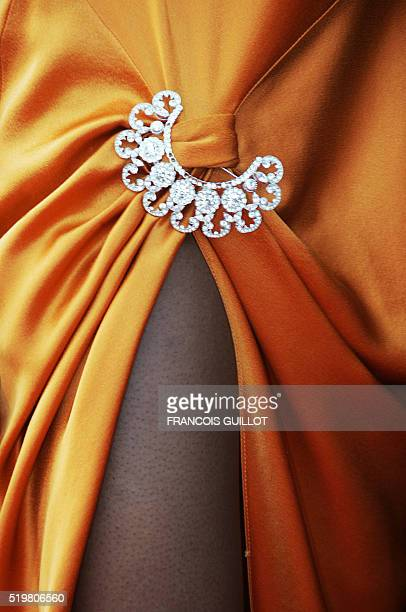 Picture shows the detail of a dress worn by a guest who arrived to attend the official projection of 'Shrek 2' 15 May 2004 at the Cannes Film...