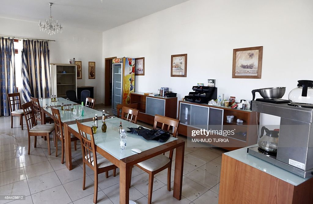 A picture shows the dining room in a villa at the US diplomatic compound in the Libyan capital Tripoli on August 31 after members of the Fajr Libya...