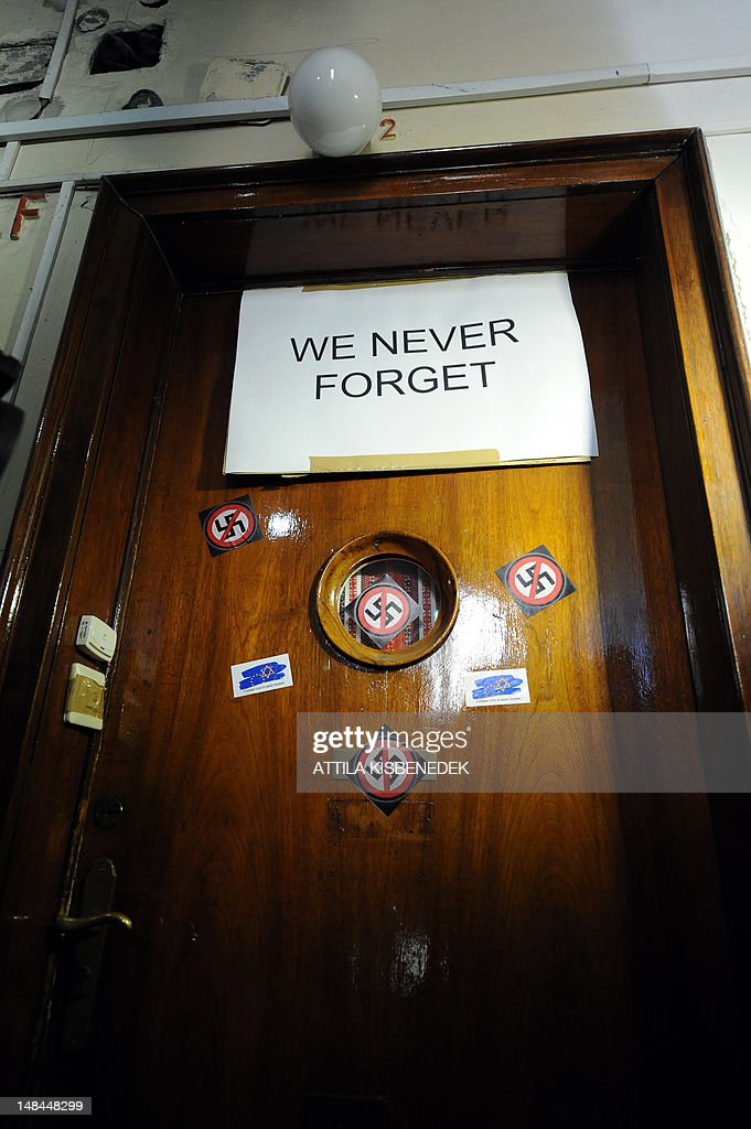 A picture shows the door of Laszlo Csatary's hideaway building, only few kilometers from his home in Budapest on July 16, 2012, on which activists of the European Union of Jewish Students have pasted 'No Nazi' symbols and a protest slogan prior to their protest against Csatary, called after a Hungarian prosecutor said that investigating an aged Nazi war criminal found alive and well in Budapest was problematic because the events took place so long ago and in a different country. A probe into Laszlo Csatary, 97, began in September after information was received from the Nazi-hunting Simon Wiesenthal Center, which ranks him number one on their wanted list, the public prosecutors' office said. AFP PHOTO / ATTILA KISBENEDEK