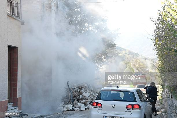 A picture shows the dust caused by the collapse of a building in the village of Borgo Sant'Antonio central Italy that was hit by earthquakes on...
