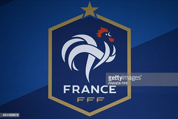 A picture shows the emblem of the French Football Federation during a press conference in ClairefontaineenYvelines on the first day of the French...