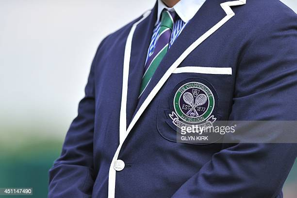 A picture shows the emblem on the front of the jacket of an umpire on day two of the 2014 Wimbledon Championships at The All England Tennis Club in...