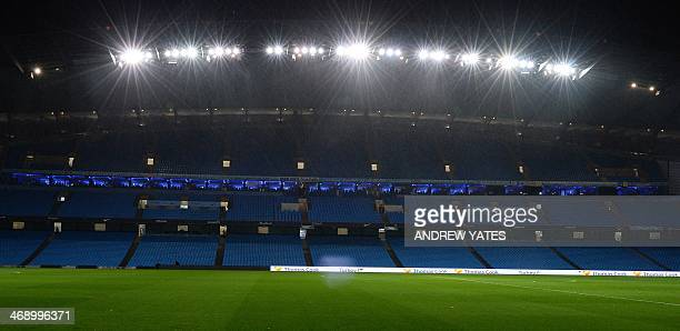 A picture shows the empty stadium and pitch after the English Premier League football match between Manchester City and Sunderland was postponed due...