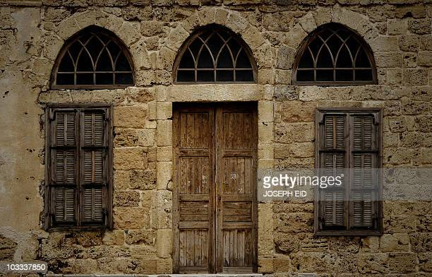 A picture shows the entrance to a nineteenth century house near the Crusaders' Citadel in the Lebanese ancient port city of Byblos on August 10 2010...
