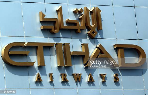 A picture shows the Etihad Airways logo at the airline's headquarters in the Emirati capital Abu Dhabi on October 14 2012 Air FranceKLM and Etihad...