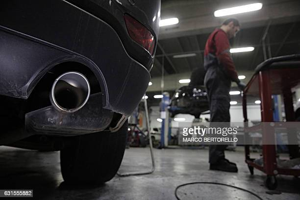 A picture shows the exhaust pipe of a car in a car repair shop on January 12 2017 in Saluzzo near Turin The United States on January 12 2017 charged...
