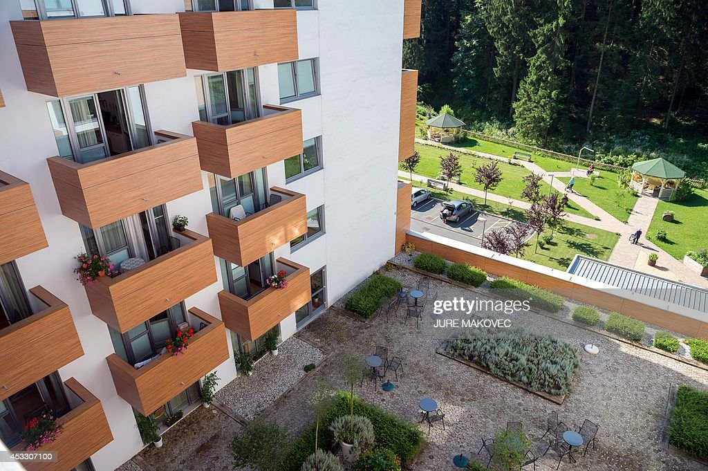 A picture shows the facade and terrace of a care home for the elderly in Topolsica on July 24, 2014, where Miquel Ribas, an 82-year old Spaniard, stayed during a week-long trip to Slovenia. Ribas, who lives in a care home in Mataro, on the Spanish coast near Barcelona, has free accommodation during his trip in a similar care home in Slovenia, provided by Jozica Kucera, a 77-year-old Slovenian widow, who will spend the same time in his room in Spain. This is the first international exchange of rooms in care homes for seniors, organized by social networking agency Linkedage, a Slovenian company that developed a web platform to link residences all over Europe and the world to enable similar exchanges or to rent vacant rooms.