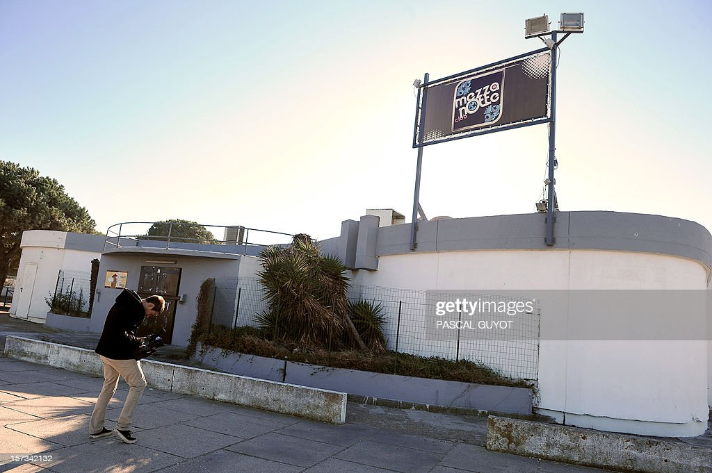 A picture shows the facade of the 'La Mezza Notte' night club on December 2, 2012 in Grau-du-Roi, near Nimes, southern France, where a bouncer was killed by a gunshot in the morning of December 2 during a brawl. The presumed killer, a 20-year-old man, turned himself in to the police, and admitted getting a gun from his car before killing the bouncer, the Nimes prosecutor said.