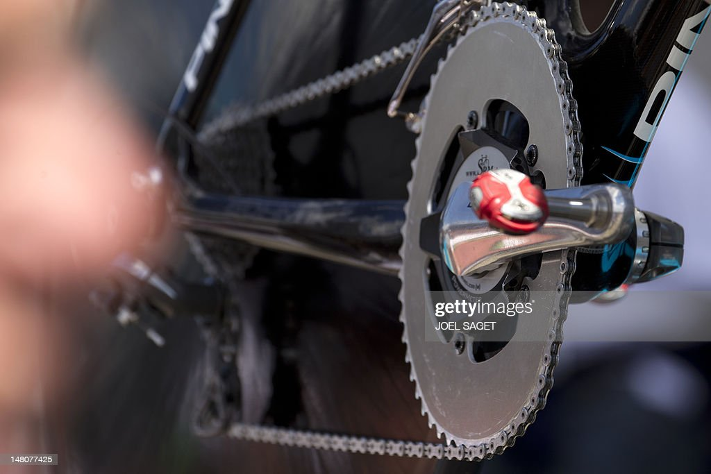 A picture shows the flattened Osymetric chainrings on the bike of Overall leader's yellow jersey, British Bradley Wiggins, prior to the beginning of the 41,5 km individual time-trial and ninth stage of the 2012 Tour de France cycling race starting in Arc-et-Senans and finishing in Besancon, eastern France, on July 9, 2012.