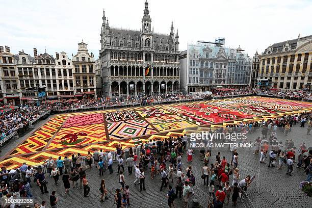 A picture shows the Flower Carpet 2012 on the Grand Place Grote Markt in Brussels on August 15 2012 The Grand Place was decked out with 600000...