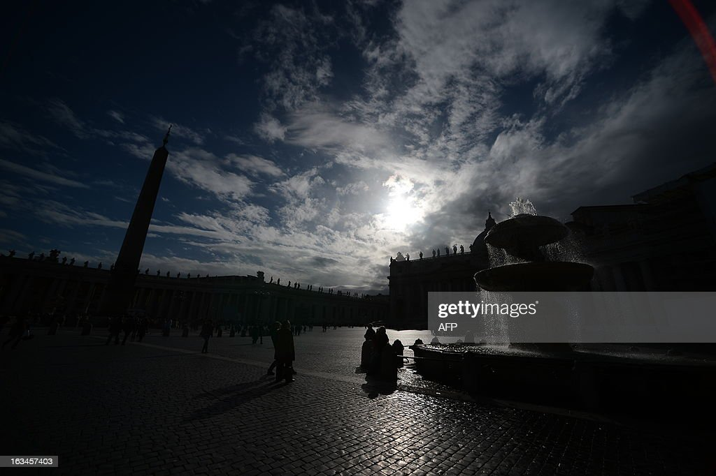 A picture shows the fountain at St Peter's square and silhouettes of statues on the colonnade at the Vatican on March 10, 2013. Roman Catholic cardinals from around the world will assemble in the Vatican's Sistine Chapel from March 12, 2013 for a conclave to elect a new pope in an unprecedented transition after Benedict XVI's historic resignation.