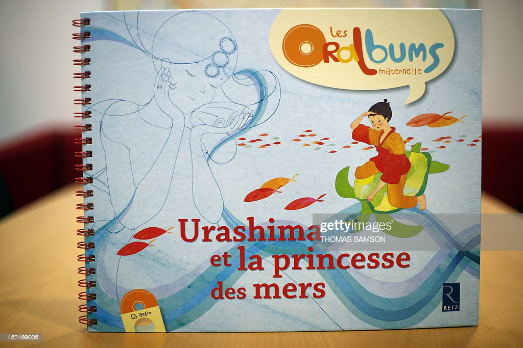A picture shows the front page of the 'Oralbum' children's book 'Urashima et la princesse des mers' (Urashima and the Sea Princess), written by Virginie Leroy and illustrated by Mizuho Fujisawa, on November 29, 2013 in Paris. The book is part of a collection presented during the 2013 'Children's Book and Press Fair' of Montreuil, outside Paris, which offers texts written in an oral language in order to adapt to the comprehension of children.