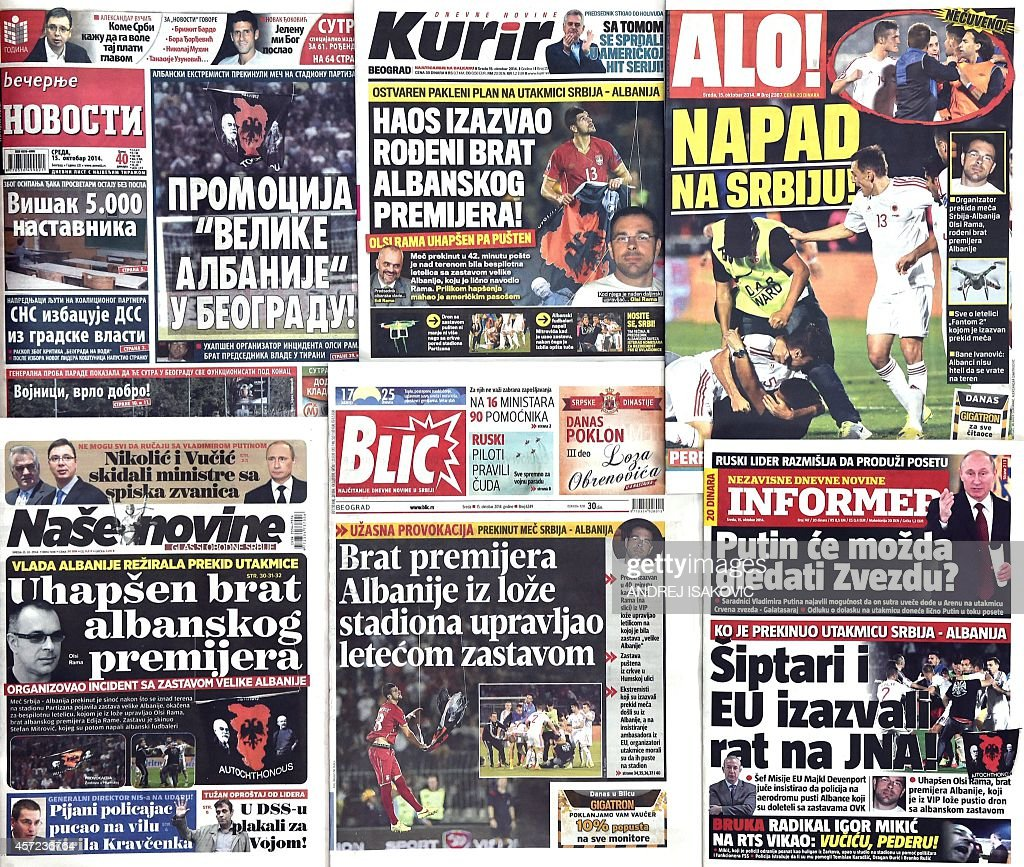 A picture shows the front pages of major Serbian newspapers featuring a story about the abandoned UEFA Euro 2016 qualifying football match between...