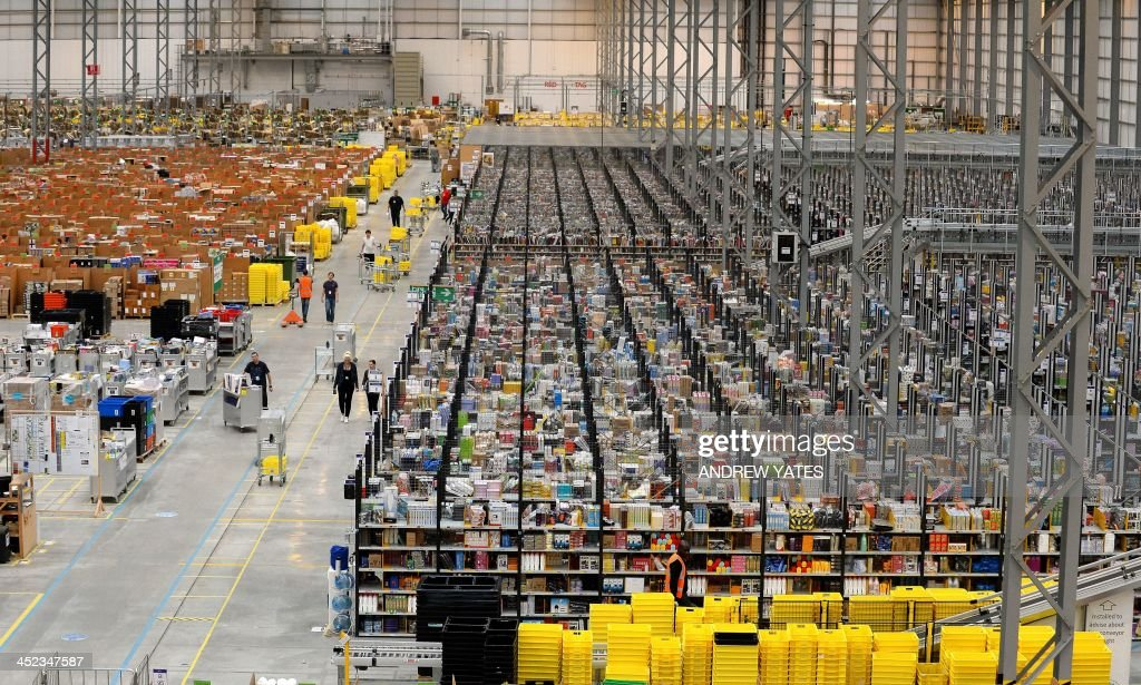 A picture shows the Fulfilment Centre for online retail giant Amazon in Peterborough, central England, on November 28, 2013, ahead of Cyper Monday on December 2nd, expected to be one of the busiest online shopping days of the year. AFP PHOTO/ANDREW YATES