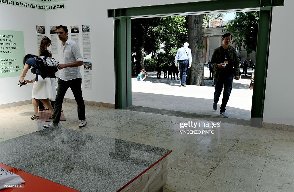 A picture shows the German 'Open Pavillon' with open doors an historic building representing the open borders for refugees, during the opening of the 15th International Architecture Exhibition in Venice on May 26, 2016. The Biennale, entitled 'Reporting from the front', curated by Chilean Alejandro Aravena will be open to the public from May 28 through November 27, 2016, in The Arsenal gardens. / AFP / VINCENZO