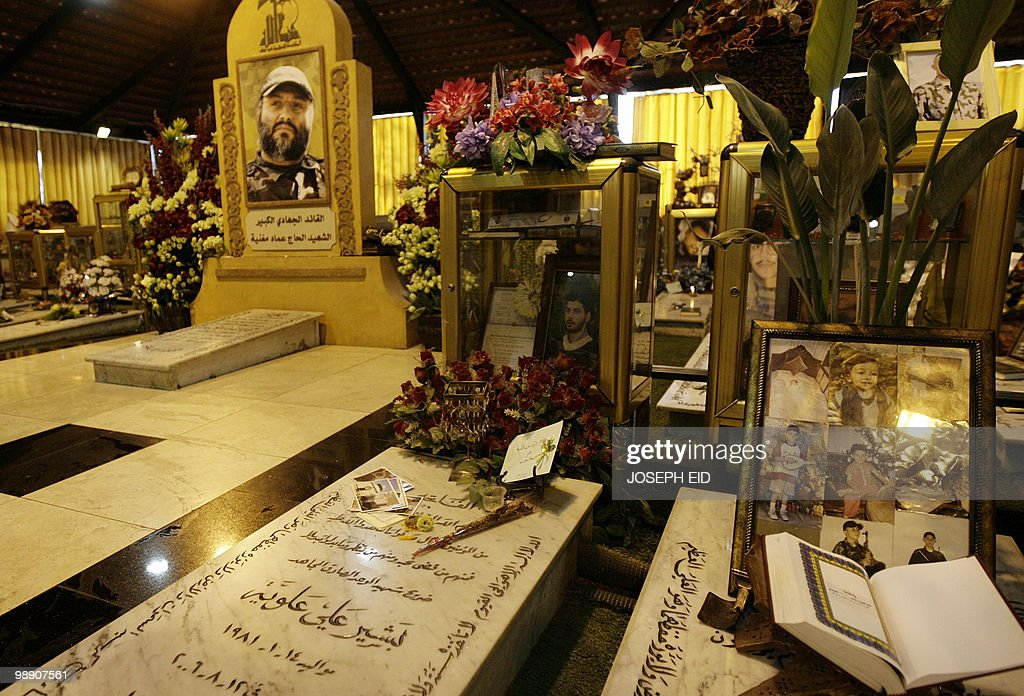 A picture shows the grave of slain Hezbollah commander Imad Mughnieh and the tombs of other Hezbollah militants in southern Beirut on February 16...