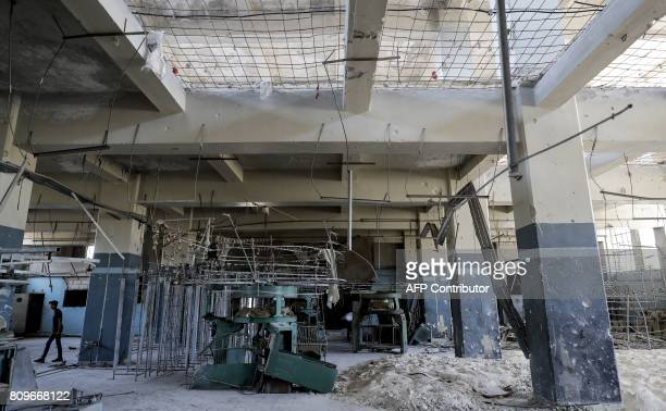 A picture shows the interior of an inactive textile factory in Aleppo's northwest Layramoun industrial district on July 5 2017 Six months after...