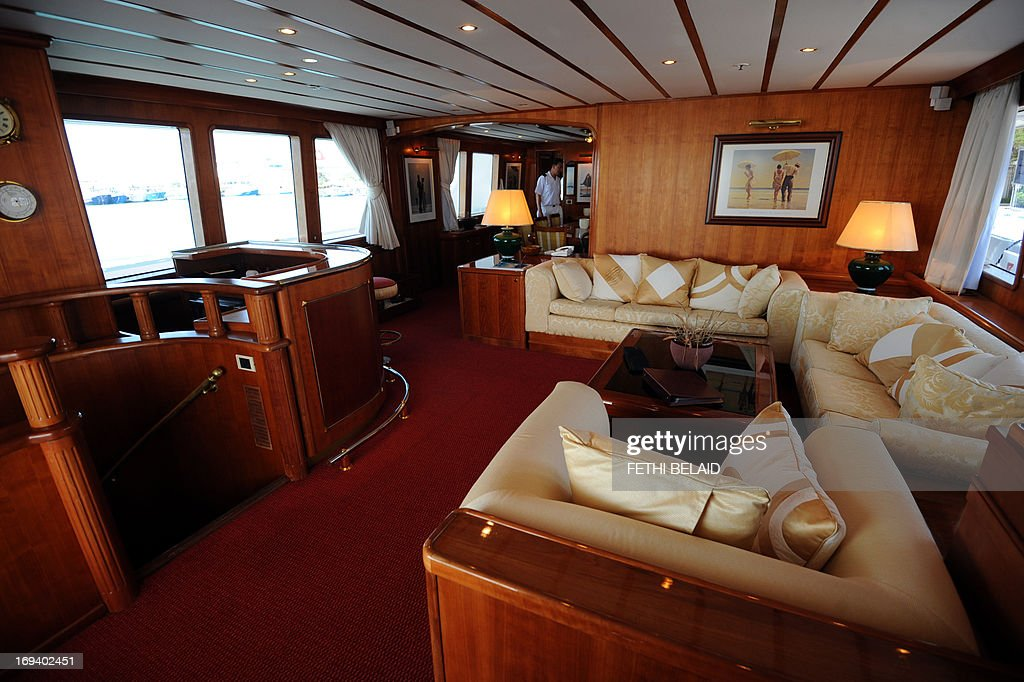 A picture shows the interior of the '5 Fishes' yacht which used to belong to Belhassen Trabelsi, the brother-in-law of ousted dictator Zine El Abidine Ben Ali, at the port of La Goulette in Tunis on May 24, 2013. Tunisian authorities have placed the yacht with an estimated value of eight million euros (over 10 million US dollars) on sale, but have so far received only one offer of seven million euros which they have refused.